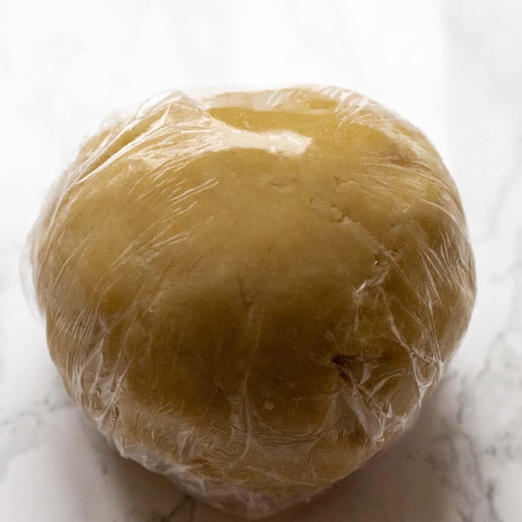 Shortcrust pastry wrapped in cling film