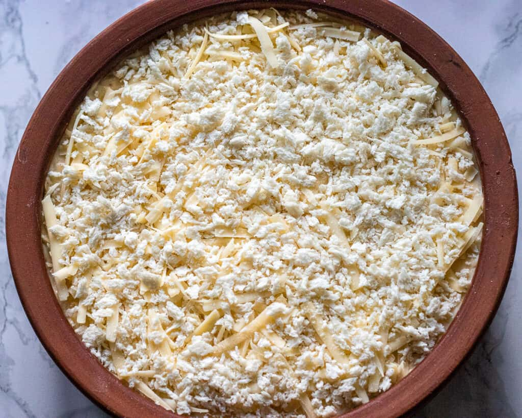 Grated cheese and breadcrumbs added to the top of the béchamel.