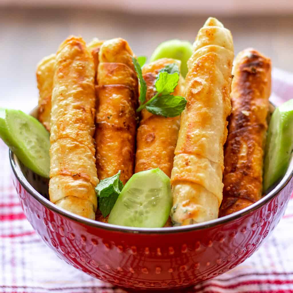 crispy Turkish cheese rolls - sigara borek filled with feta and halloumi