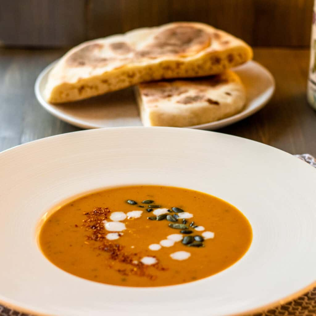"""autumn squash soup garnished and served with Turkish flatbread called """"Bazlama"""""""