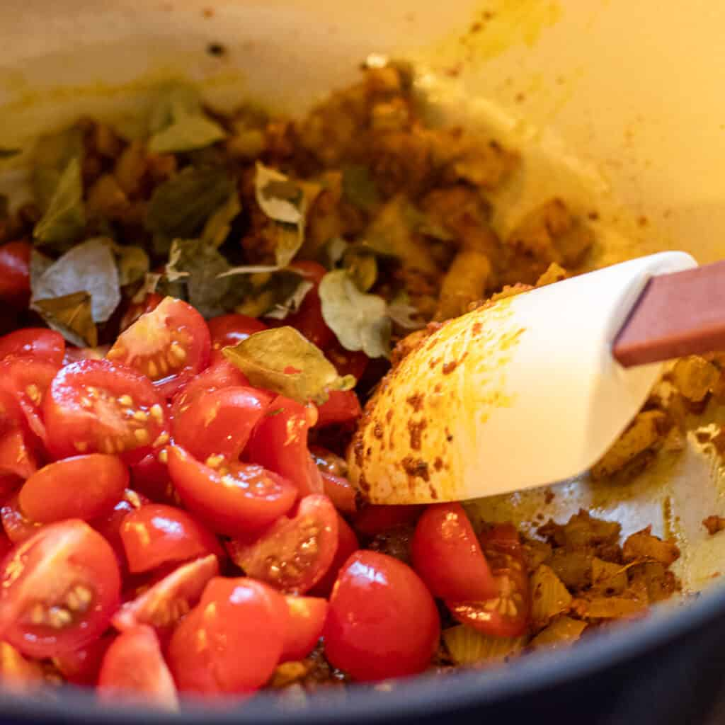 Tomatoes added to onions.