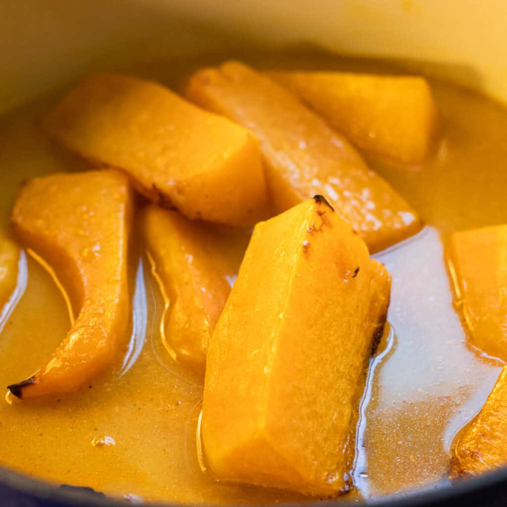 Roasted butternut squash added to the soup base