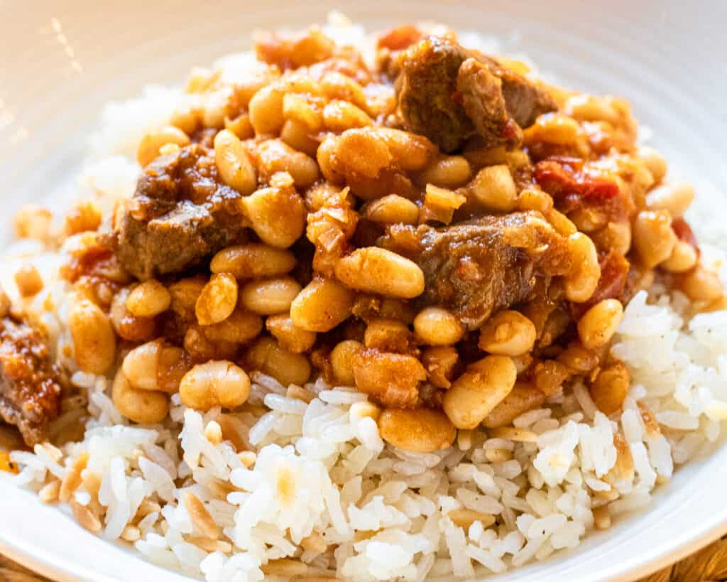White bean stew with lamb served with Turkish rice pilaf.