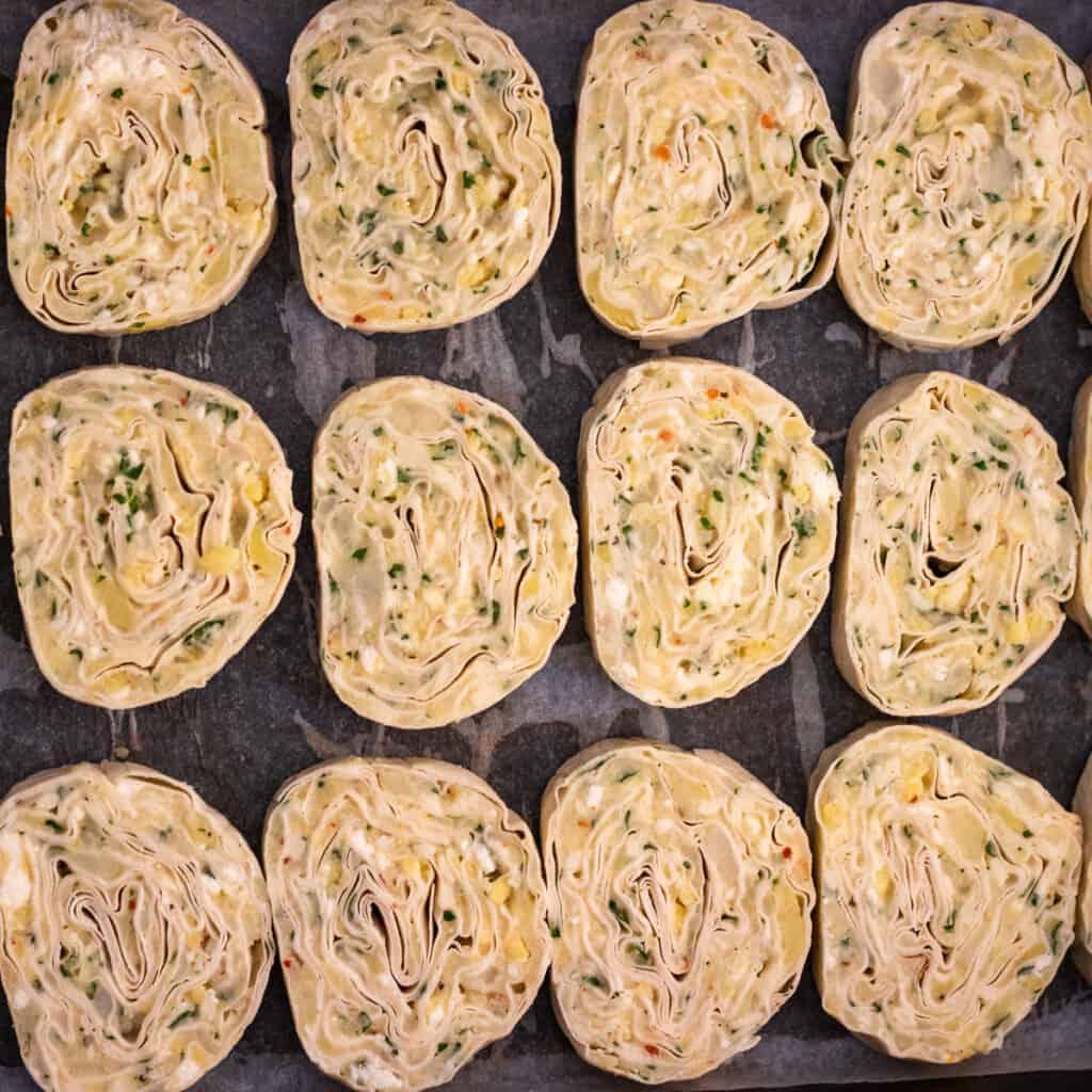 Slices of potato borek slices layered on a baking tray