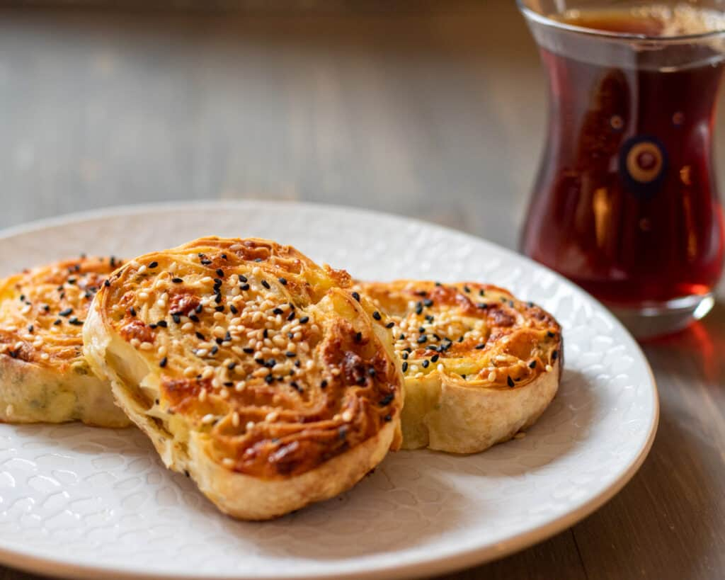 Potato borek served with a cup of Turkish tea