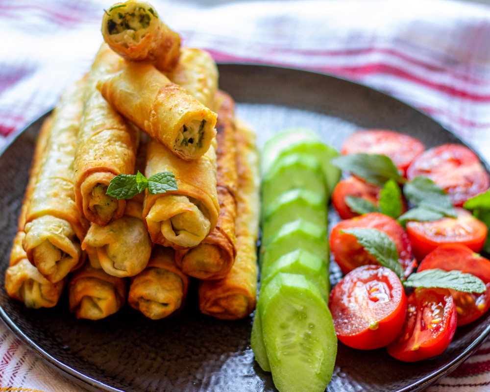 sigara borek-Turkish cheese rolls served with cucumbers and tomatoes